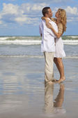 Man and Woman Couple Having In Romantic Embrace On Beach — Stock Photo