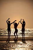 Three Young Women Dancing On Beach At Sunset — Stock Photo