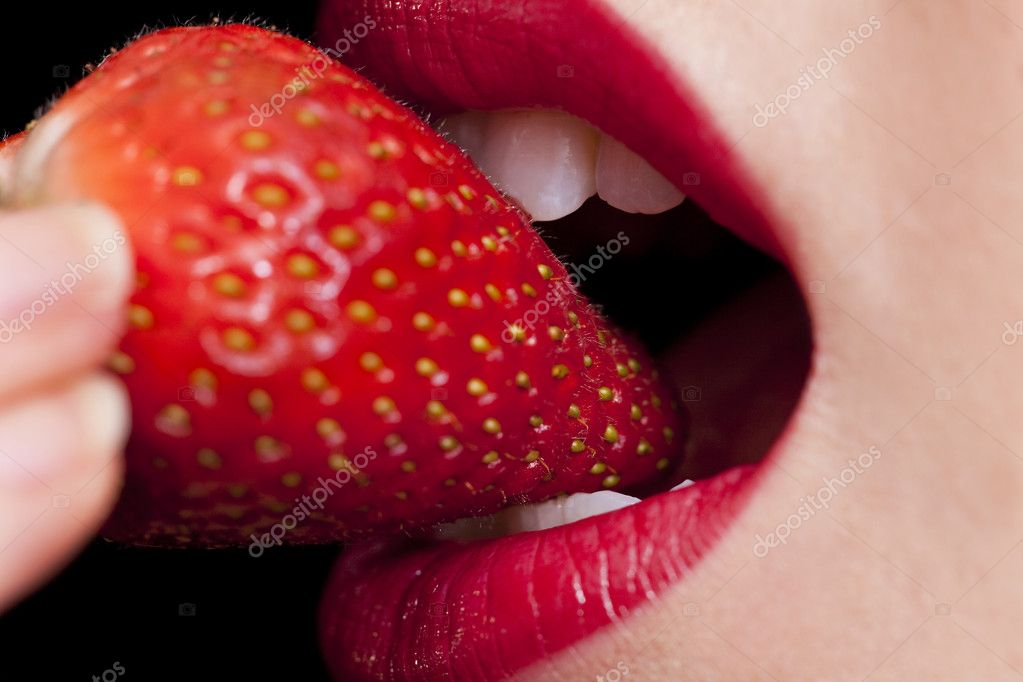 Macro close up of a beautiful female mouth eating a fresh strawberry — Stock Photo #6470182