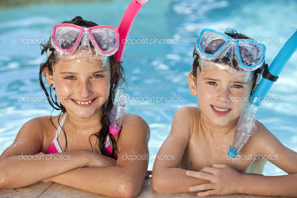 Boy And Girl In Swimming Pool With Goggles And Snorkel Stock Photo Dmbaker 6479254