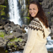 Beautiful and Happy Scandinavian Woman In Front Of A Waterfall — Stock Photo