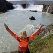 图库照片: Woman Celebrating At Godafoss Waterfall, Iceland
