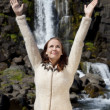 Beautiful Young Woman Celebrating Arms Raise By A Waterfall — Foto Stock