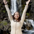Stock Photo: Beautiful Young Woman Celebrating Arms Raise By A Waterfall