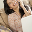 Beautiful Latin Hispanic Woman Using Cell Phone and Laptop Compu — Stock Photo #6480626