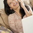 Beautiful Latin Hispanic Woman Using Cell Phone and Laptop Compu — Stock Photo