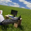 Businessman Relaxing In a Green Office — Stock Photo