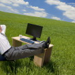 Businessman Relaxing In a Green Office — Stock Photo #6481633