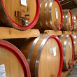 Barrels of Chianti Wine in a Winery Cellar - Stock Photo
