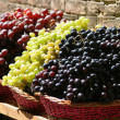 Baskets of Grapes in Fruit Market — Stock Photo