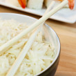 Rice and Chopsticks With Sushi — Stock Photo #6482005