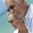 Happy Senior Couple Looking To Sea on A Tropical Beach — Stock Photo