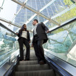 Executives on an Escalator — Stock Photo #6482952