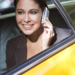 Young Woman Talking on Cell Phone in Yellow Taxi — Stockfoto