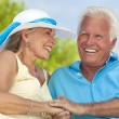 Happy Senior Couple Holding Hands & Laughing at the Beach — Stock Photo