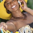 African American Woman With Fashion Shopping Bags on Cell Phone — Stock Photo