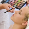 Beautiful Woman Having Make Up Applied by Beautician at Spa — Stock Photo #6485137