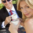 Attractive Businessman and Woman Couple Drinking Coffee At Outdo — Stock Photo