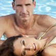 Beautiful Couple Relaxing By Swimming Pool — Stock Photo
