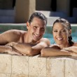 Beautiful Couple Relaxing In Swimming Pool With Perfect Smiles — Stock Photo #6485578