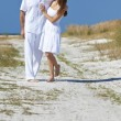Couple Walking on An Empty Beach — Stock Photo