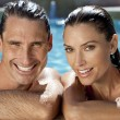 Stock Photo: beautiful couple relaxing in swimming pool with perfect smiles