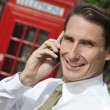 Businessman On Cell Phone In London With Red Telephone Box — Stock Photo
