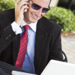 Businessman In Sunglasses Using Laptop Computer and Cell phone — Stock Photo