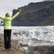 Stock Photo: WomHiker Celebrating Arms Raised By Vatnajokull Glacier Icela