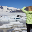 Environmental Concept Woman Hiker Looking At Melting Glacier — Stock Photo #6485974