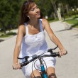 Royalty-Free Stock Photo: Beautiful Woman Cycling In White Sun Dress