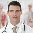 Male Doctor In Hospital With Human Anatomy Charts — Stock Photo