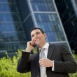 Businessman Talking On His Cell Phone In A Modern City — Stock Photo #6486747