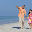 Father and Daughter Walking Holding Hands on Beach — Stock Photo #6486899