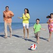 Mother, Father and Children Family Running With Football on Beac — Stock Photo #6486956