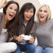Three Beautiful Women Friends Playing Video Games at Home — Stock Photo #6487018