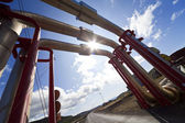 Industrial Pipeline Going Up and Over A Road — Stock Photo