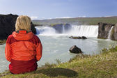 Woman Sitting At Godafoss Waterfall In Iceland — Stock Photo