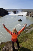 Woman Celebrating At Godafoss Waterfall, Iceland — Stock Photo