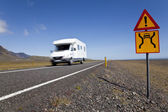 Motor Home Driving On An Open Road With Danger Sign — Stock Photo