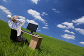 Man Relaxing At Office Desk In a Green Field — Stock Photo