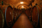 Barrels of Chianti Wine in a Winery Cellar — Stock Photo