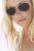 Backlit Photograph of Sexy Blond Girl In Aviator Sunglasses — Stock Photo