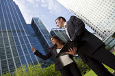 Happy Mixed Race Businessman and Businesswoman Team In the City — Stock Photo