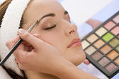 Beautiful Woman Having Make Up Applied by Beautician at Spa — Stock Photo