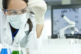 Female Scientist or Woman Doctor With Test Tube In Laboratory — Stock Photo
