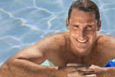 Handsome Middle Aged Man Relaxing In Swimming Pool — Stock Photo