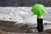 Environmental Concept Of A Woman With Green Umbrella By Glacier — Stock Photo