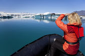 Woman Explorer Using Boat in Iceberg Field, Jokulsarlon Lagoon, — Stock Photo