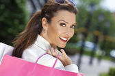 Beautiful Happy Woman With Pink and White Shopping Bags — Stock Photo